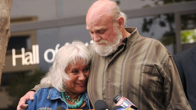 Michael Hanline and his wife Sandy answer questions from the media after his case was dismissed in Ventura, Calif., Wednesday.