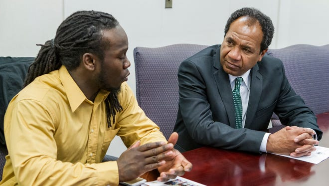 Henry Murray (left) talks with Wilmington Mayor Dennis P. Williams during the mayor's open hours Wednesday afternoon. Murray wanted to discuss finding affordable housing for his grandmother and disabled brother.
