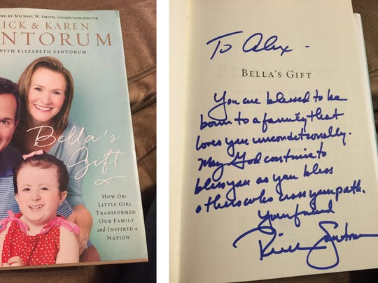In this composite image provided by the campaign, a hand-written message from Rick Santorum  is inscribed to the Buck family on a copy of the book that Santorum and wife Karen wrote about their daughter, Bella.