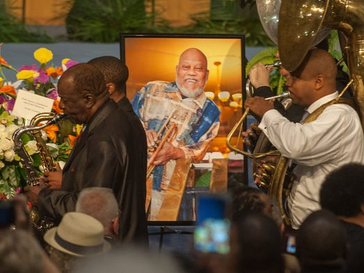 The Gabriel Marching Band passes a portrait of Marcus