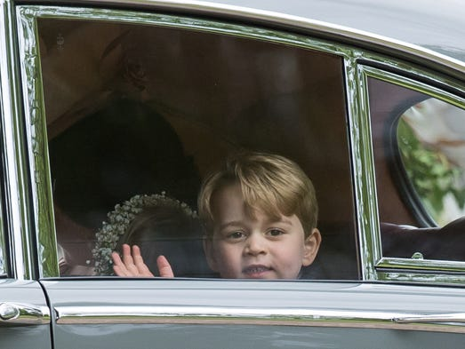 Prince George of Cambridge waves from the car after