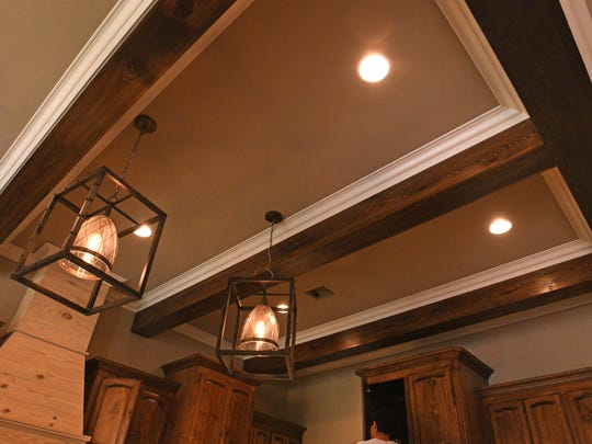 Exposed wooden beams are used at a north Benton home.