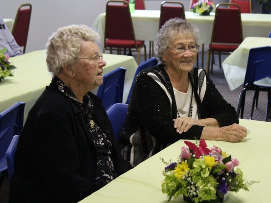 Grand Prairie Baptist Church members Violet Rowlinson, left, and Betty Gustin talk with fellow members during a birthday party for Mary Rea on Saturday at the church.