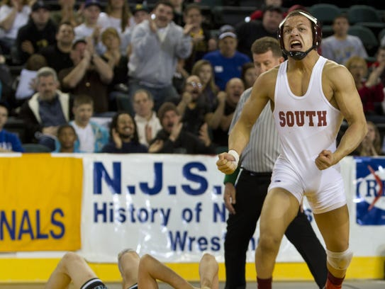 Toms River South's B.J. Clagon celebrates after pinning