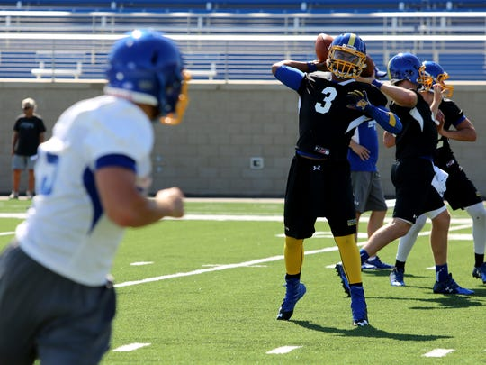 Taryn Christion throws a pass during practice.