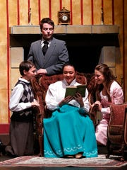 The Banks family, played by Ryan Schneider, Gavin Hambrick, Kim Richardson, and Olivia Rose Wall, spend family time together during a dress rehearsal of Mary Poppins, at the Fond du Lac High School P.A.C.