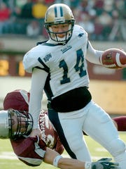 Montana State's Travis Lulay scrambles for yardage