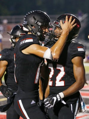 Lafayette Jeff quarterback Mathew Wilkerson celebrates with Lattrell Brown after Brown ran for a touchdown at 1:42 in the first quarter against Marion Friday, September 22, 2017, at Scheumann Stadium. Jeff defeated Marion 37-31.