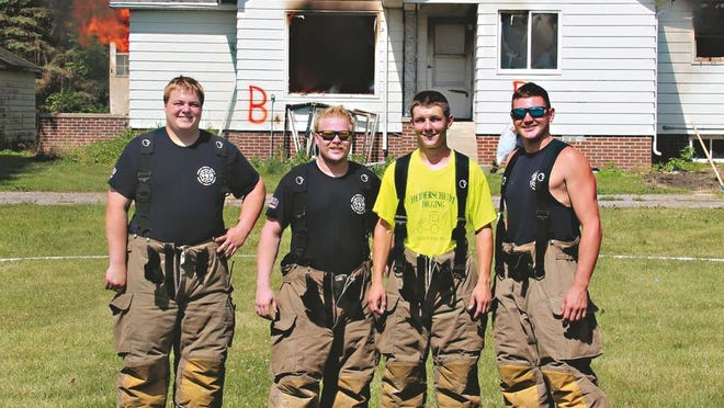 Sleepy Eye's newest firefighters posed for a picture after completing the house burn drill, from left: Colten Borth, Aaron Bruggeman, Tyler Heiderscheidt, and Logan Zuhlsdorf.