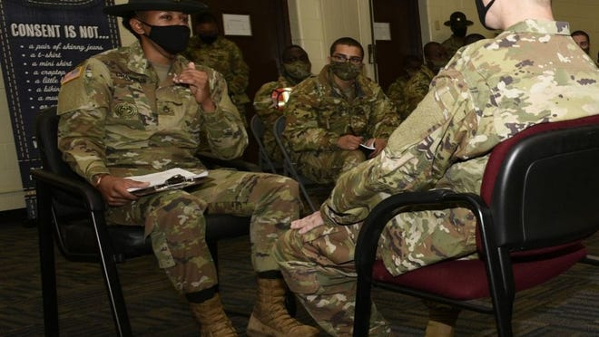Staff Sgt. Crystal Chavous, a drill sergeant assigned to Company B, 2nd Battalion, 10th Infantry Regiment, goes through a sexual harassment reporting scenario while trainees listen and take notes during SHARP training Jan. 15.