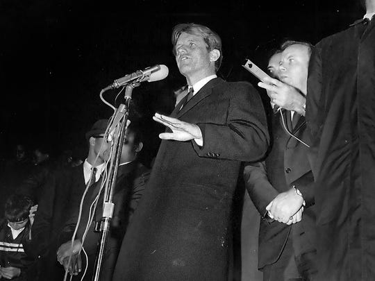 Sen. Robert F. Kennedy (D-N.Y.), looking pale and shaken at the news of Dr. Martin Luther King's assassination, disregarded his prepared speech on April 4, 1968, and spoke briefly to a crowd of 2,500 in Indianapolis, urging those in attendance not to meet violence with violence.