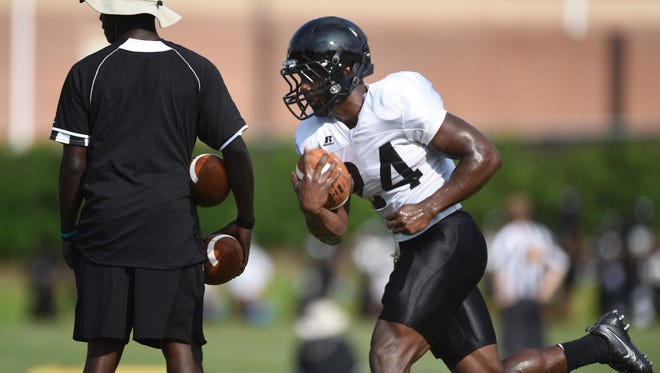 Southern Miss running back George Payne runs a drill during the first full week of fall football camp on Tuesday.
