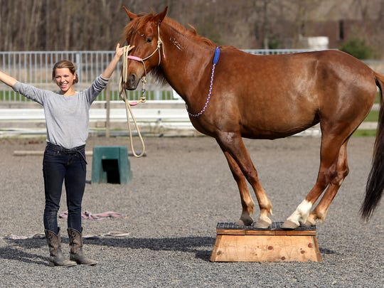 Cat Zimmerman, a 14-year-old from Morristown, practices with her wild mustang, Comancheria at Seaton Hackney Stables in Morristown in preparation for her performance  in the Midwest Horse Fair's Epic Night of the Horse, Youth Star Search Competition. Zimmerman was selected out of hundreds of applicants to be one of five youths to compete in Madison, Wisconsin. April 15, 2017, Morristown, NJ