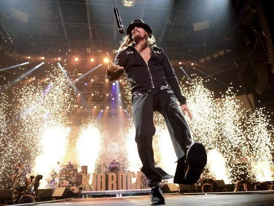 Recording artist Kid Rock flips his microphone as he performs during Tiger Jam 2013 at the Mandalay Bay Events Center