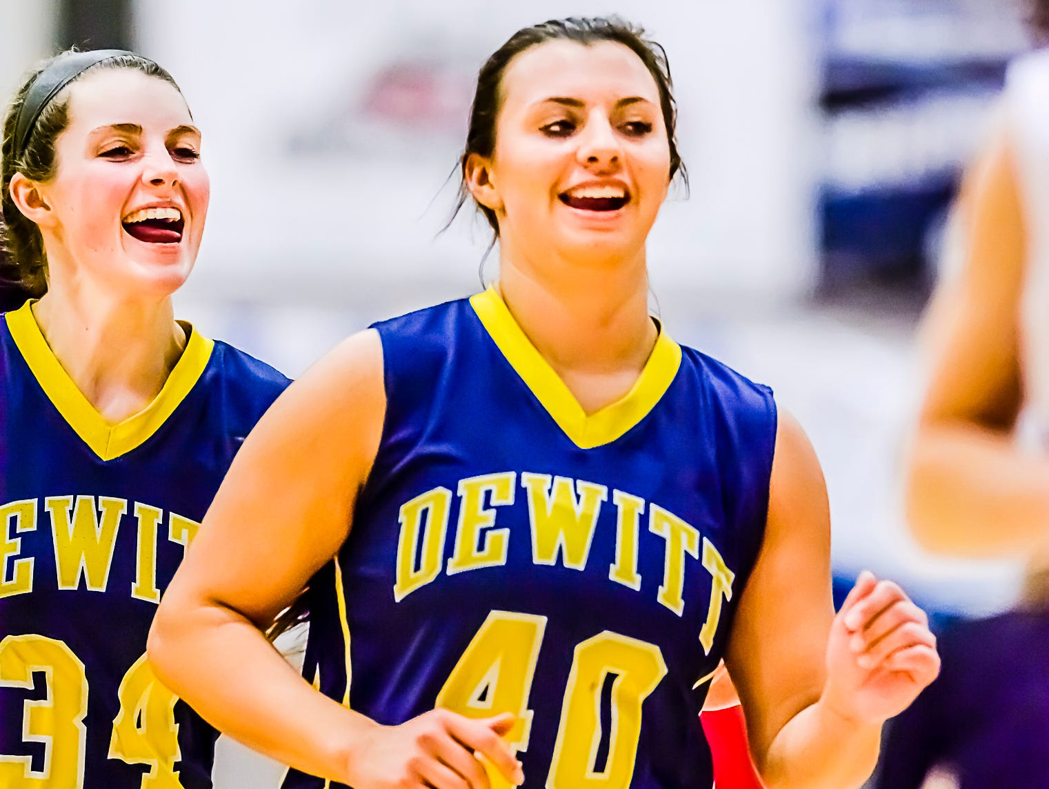 Grace George ,left, and Summer Ward of DeWitt smile as they leave the court after their win over St. Johns Friday February 5, 2016 in St. Johns. KEVIN W. FOWLER PHOTO