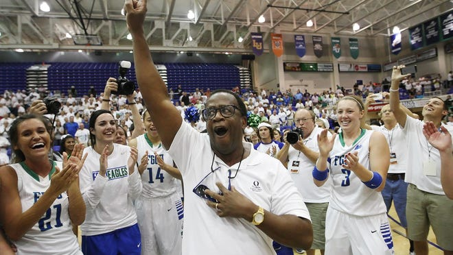 FGCU President Wilson Bradshaw (center) knows the importance athletics plays in the university's overall reputation after the 2013 Dunk City electrifying run as he celebrates here with women's basketball team after winning the Atlantic Sun Conference tournament championship this year.