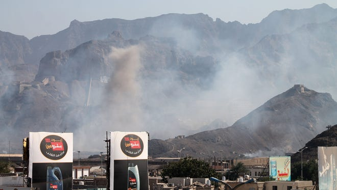 Smoke billows from the site of an explosion that hit an arms depot in Yemen's second city of Aden on March 28, 2015.