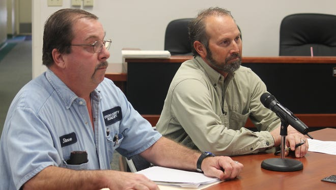 Otero County Road Superintendent Steve Quappe  and Alamogordo Public Schools Operations and Transportation Director Vance Lee discuss the La Luz Canyon Road and school bus route issue at the Dec. 10 Otero County Commission meeting.