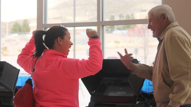 Gene Dennis, polling volunteer, congratulated an excited Alamogordo resident after casting her ballot on Tuesday.