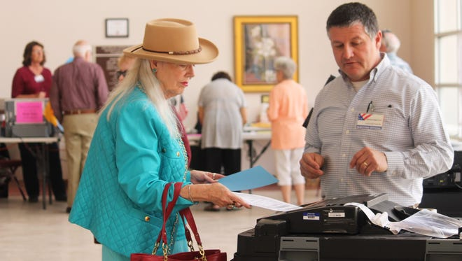 Carla Kerr inserts her ballot at the Tays Special Events Center on Tuesday afternoon.