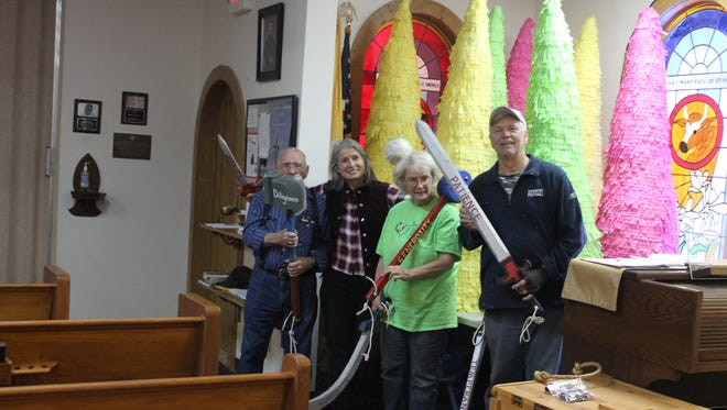L to R: Dave Arnold, Loudes Blette, Helen Rieggeri and Mike Blette holding the weapons of virtue  representing  good always defeats evil