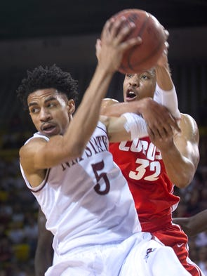 Nmsu basketball aggies fall to lobos in rivalry opener for Matt taylor shirt buy