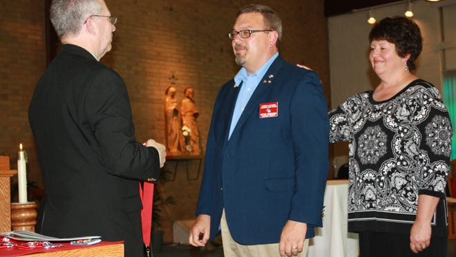 Ronald Faust, left, state deputy for Wisconsin Knights of Columbus, recently appointed Peter Denissen, middle, of Green Bay as district deputy. Also pictured is Denissen's wife, Leanne. Denissen will work with the Knights of Columbus councils in Green Bay, Denmark and Luxemburg.