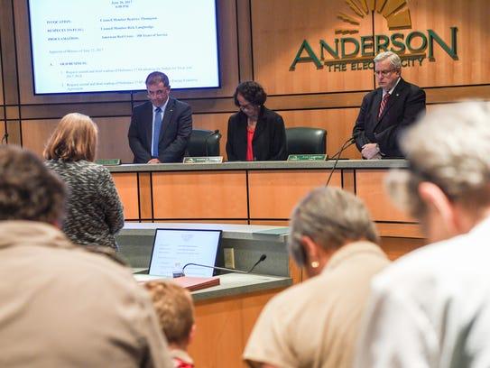 Anderson CIty Councilwoman Beatrice Thompson, center,