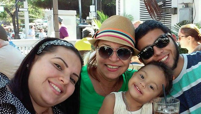 Heyzel Obando (left) is pictured with her mother Isabel Martinez, brother and daughter.