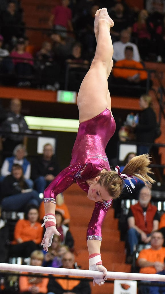 Oregon's State's Madeline Gardiner competes in the bars during a meet against Arizona on Saturday, Feb. 7, 2015, in Corvallis.