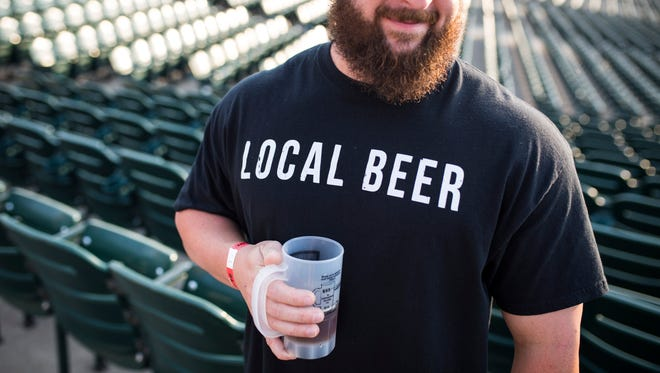 """Avid beer fan Tyler Stallings makes a point to visit breweries in the local area, but was happy to see new faces at the 2016 Louisville Brewfest at Louisville Slugger Stadium. """"There's several here that we hand't seen yet,"""" Stallings said. """"Craft beer. You can't beat it."""" Sept. 23, 2016"""