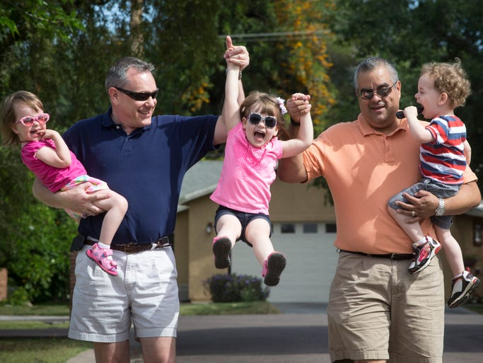 Kelsie Bell, Aaron Bell, Caitlin Bell, Sid Cuecha and Riley Bell on a morning walk in their north Phoenix neighborhood.