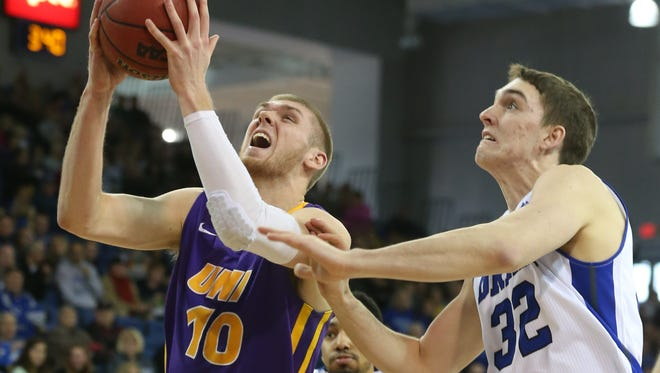 UNI forward Seth Tuttle drives the ball on Drake defender Kory Kuenstling during the first meeting this season between the Panthers and Bulldogs.