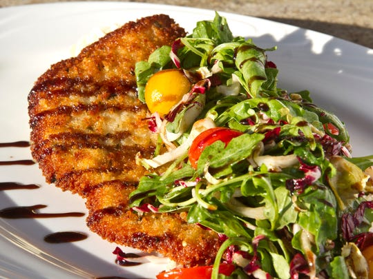 Pork cutlet Milanese with arugula, endive and radicchio salad and balsamic vinaigrette from  Waypoint 622.