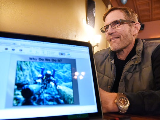 Mark Wenner talks about his work as a senior dive officer for the Cave Research Foundation Thursday, Dec. 10, in St. Cloud.
