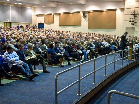 A full capacity crowd listens as Rabbi Gourarie explains