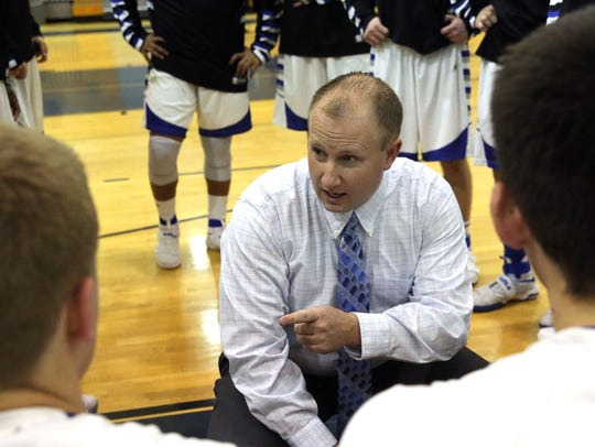 Oak Creek boys basketball coach Mike Jossie talks to his team during a timeout during a game in 2016. Jossie has been placed on unpaid leave after being charged with two counts of second-degree sexual assault of a child.
