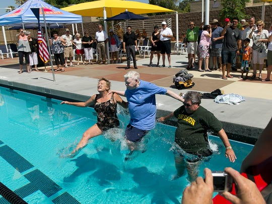 John Furbee, center, joins in the inaugural swim at the opening of the John Furbee Aquatics Center in June 2013 in Desert Hot Springs.
