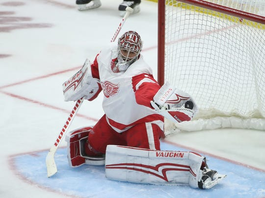 Red Wings goalie Petr Mrazek (34) makes a save against the Maple Leafs during the Red Wings' 3-2 shoot-out exhibition win over the Maple Leafs on Saturday, Sept. 30, 2017, in Toronto.