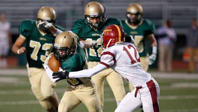 Vestal's Pierce Eynon tries to evade Ithaca's Geoffrey Washington during Thursday's game in Vestal.