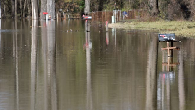 Flood waters overtake Chickasaw Road in Vicksburg Wednesday as the Mississippi River continues to rise.