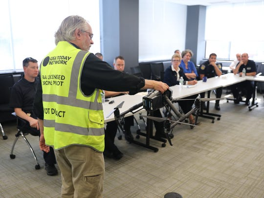 Local law enforcement personnel attend a community outreach program by  lohud.com drone pilots Ricky Flores and Peter Carr, pictured, at The Journal News offices in White Plains, New York, Sept. 12, 2017.