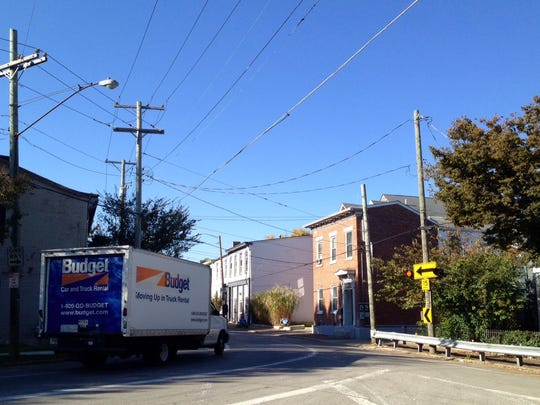 A truck heads into the sharp curve at Brownsboro Road at Story Avenue in Butchertown.
