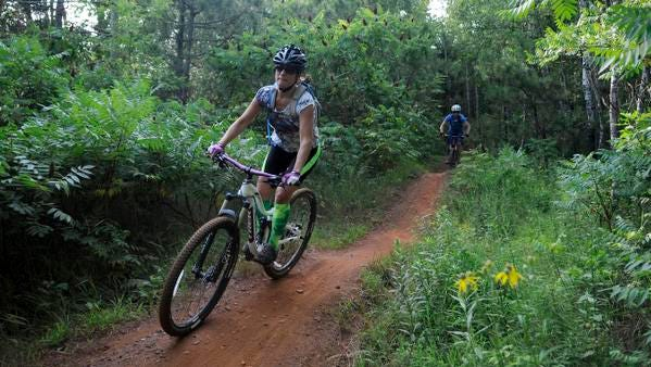 Kathy Hartman rides the bobsled trail in the Yawkey area of the Cayuna Country State Recreation Area on. Improvements to Cuyuna Country State Recreation Area, a former iron ore mining site now known for its 25-mile network of mountain bike trails.