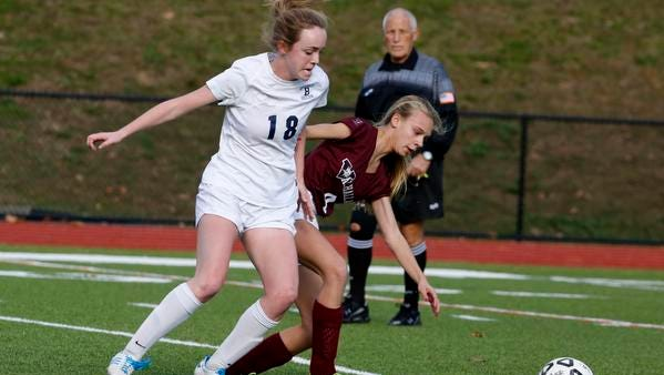 Briarcliff's Kelsey Simpson and Valhalla's Juliana Corradi battle for possession in the class B girls soccer semifinal Thursday at Briarcliff High School. Simpson scored the go-ahead goal in the second half, and Briarcliff won 3-1.