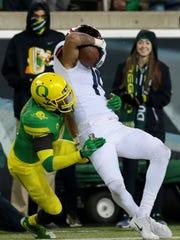 Oregon Ducks cornerback Tyree Robinson (2) tackles