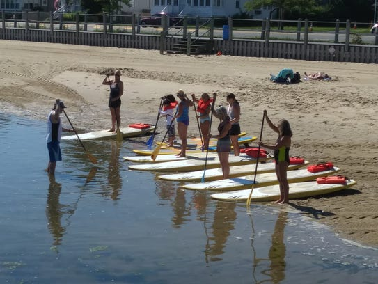 Paddlers getting a lesson on holding their paddle at