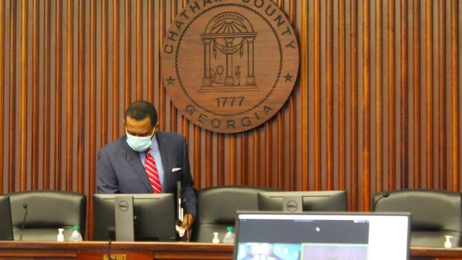 Chatham Commission Chairman Al Scott wears a face mask when arriving for a May 22 meeting at Savannah's Old Courthouse.