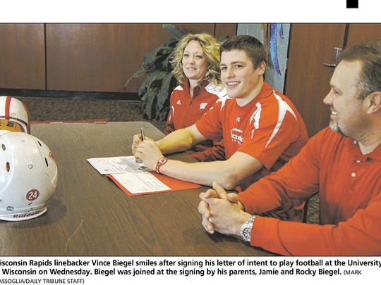 Wisconsin Rapids native Vince Biegel with his parents Jamie and Rocky Biegel on signing day in 2012. Biegel was drafted by the Green Bay Packers Saturday.