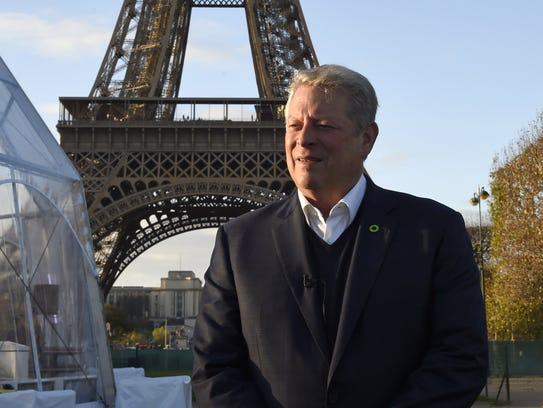 Al Gore speaks during an interview with AFP on Nov. 13, 2015 at the foot of the Eiffel Tower in Paris, ahead of a United Nations conference on climate change.